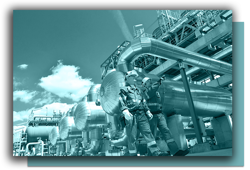 Workers walking on an oil and gas work site, where IADC RigPass® online training is crucial.