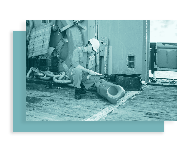 A worker on an offshore vessel communicating with his team according to our Subchapter M Survey and Audit Training.