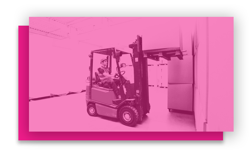 A worker operating a forklift to move boxes, demonstrating safe practices from our forklift driver safety training.